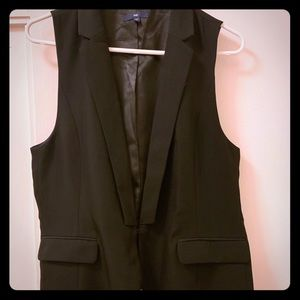 Black womens vest with pockets and back fastener